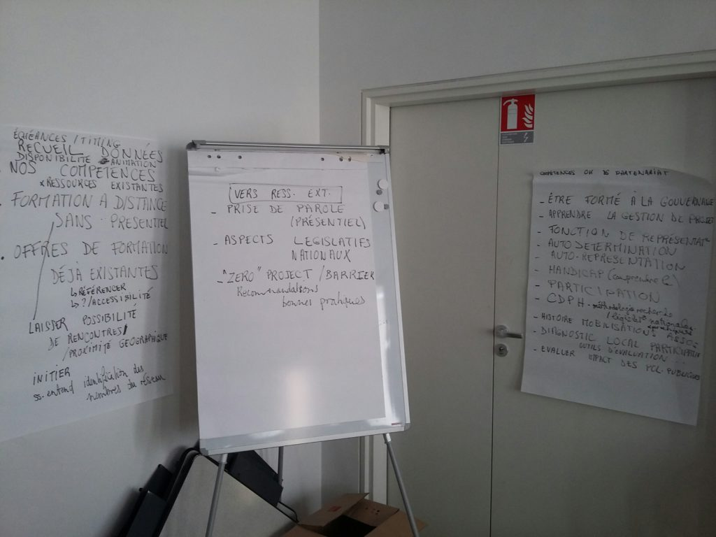 Some notes written on a paperboard.